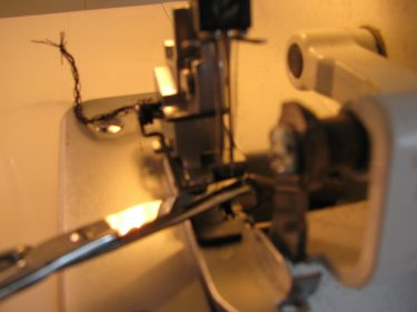 thread a serger with long tweezers, 062