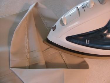 press hem on the wrong side of fabric, hem pants and skirts, 072