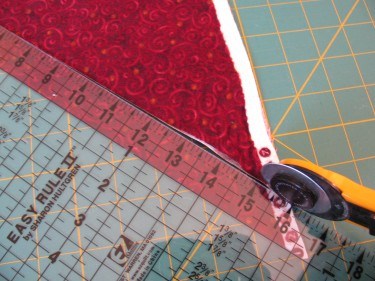 cutting the first strip of fabric to make piping, 093