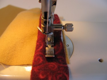 stitching piping to the main fabric using a zipper foot, 102