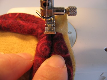 going around a curve stitching on piping with a zipper foot, 104