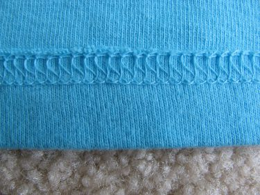back side of cover stitch on a knit top, 136