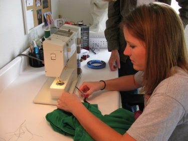 M working at the sewing machine, 141
