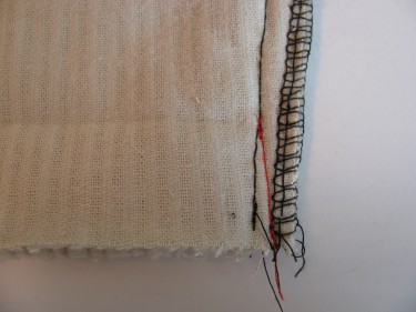 red line showing how to stitch to increase hem for tapered pants, 186
