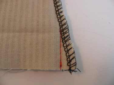 red stitching line showing how to take out some fabric on flared leg hem, 190