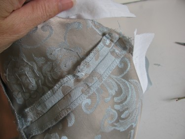 showing the ends of interfacing that need to be sewn, taking in the bust, sewing blog 230