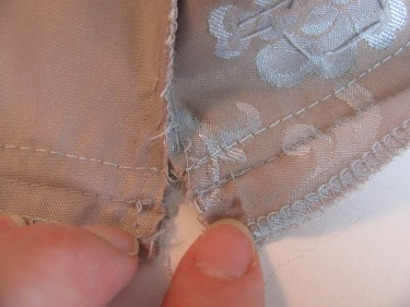 the two new seams will line up when you sew them on taking in the bust on a dress, sewing blog 236