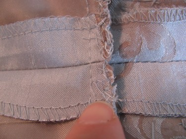 finishing the seam edge in taking in the bust of a dress, sewing blog 239