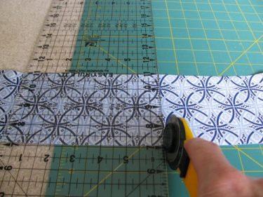 rotary cutter cutting fabric, 296