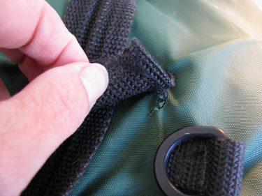 webbing torn on bag, 299