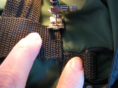 fixing loose webbing on bag, 300