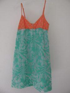 orange and teal dress for serged hem, 305