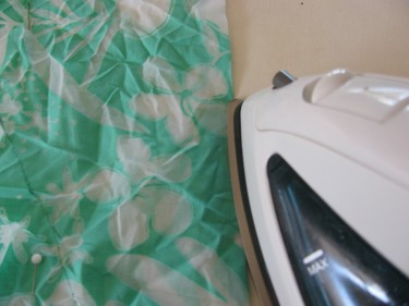 pressing teal fabric, serge a hem, 311