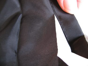 trimming off hem of pants lining, 575