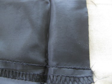 trim off excess lining material from pants, 576