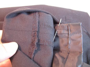 take a stitch from the lining to attach the perle cord to pants, 580