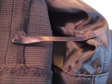 attaching ribbon between pants and lining, 583