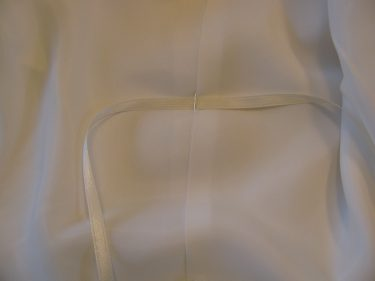 sewing ribbon onto dress for bustle, 616