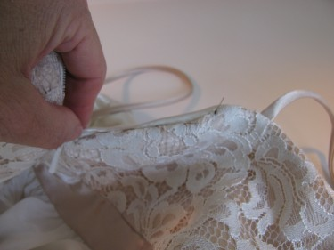 photo of pushing the points of the back of the dress into the inside, sewing blog 644