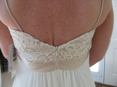 photo of back of dress with customer wearing it, sewing blog 651