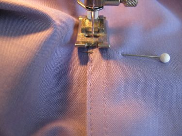 stitching the cuff back on, shortening long sleeves, 662