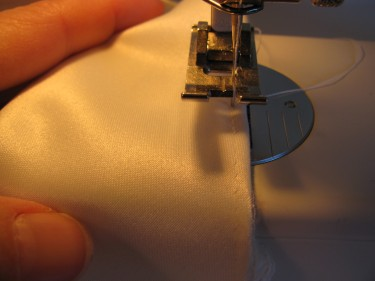 stitching really close to folded edge for partial hem, 691