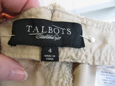 stitching the labels back on the waist, 745