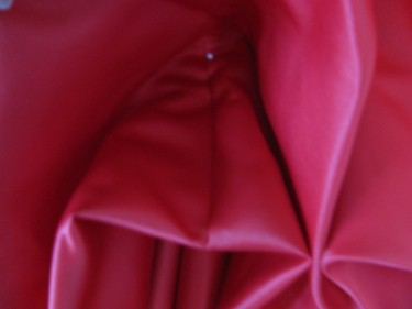 close up of pinning a bustle on red dress, 756
