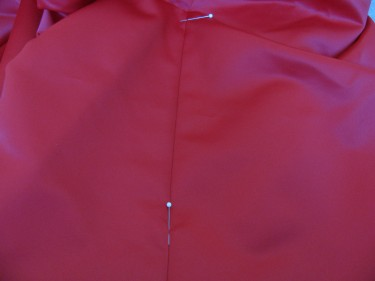 close up of pins on back of red dress, bustles, 758