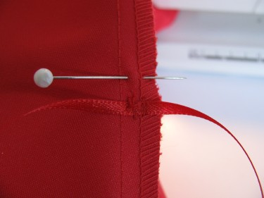 ribbon stitched in for red dress bustle, 764