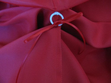 ribbon tied in a bow onto bustle ring, red dress, 766