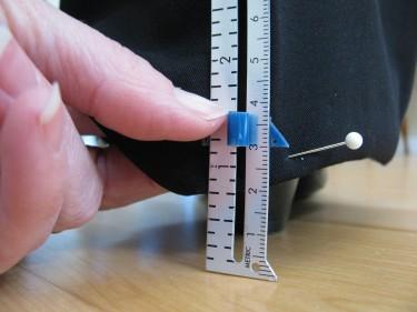 marking a hem with a seam gauge, 780
