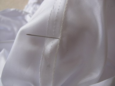 poking a pin through the back of the bubble dress, 947