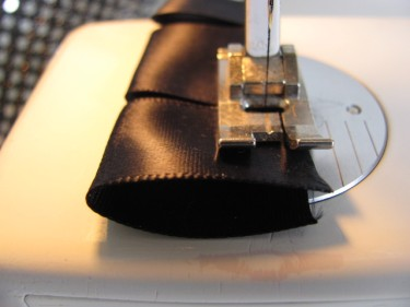 stitching loops out of black satin ribbon for corset back #2