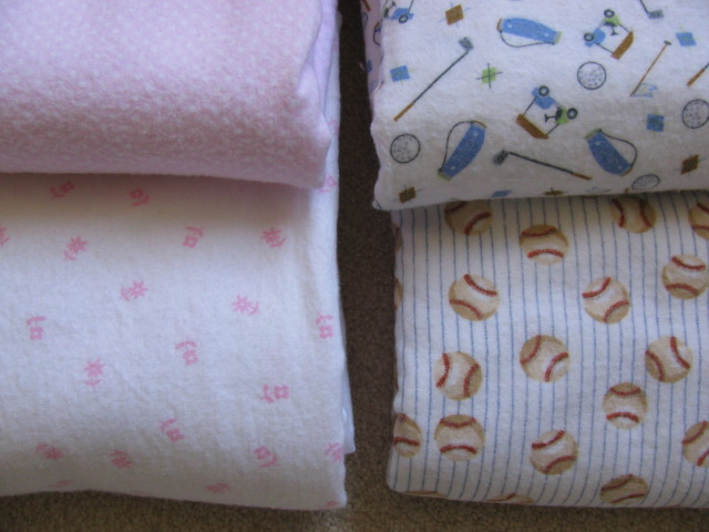 four baby blankets folded up and finished, 1032