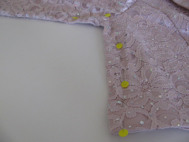 pinning up the sides of a jacket, taking in the side seams and facings, 1054