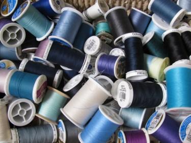 pile of blue thread spools, 1090