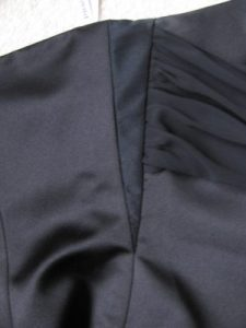 Side view of Michelle's black bridesmaid dress with gusset in the dress