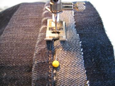 stitching the hem circle back onto the jeans higher up the leg