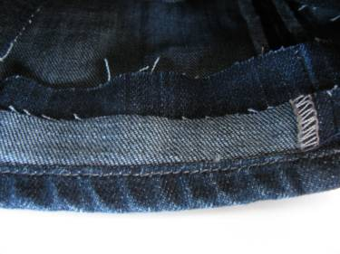 the look from the wrong side of the jeans after the hem circle is sewn on