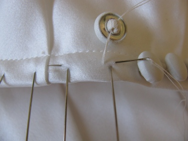 close up of the entire stitch when putting on satin covered buttons.