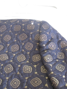 Altering the shoulders on a jacket close up of the shoulder