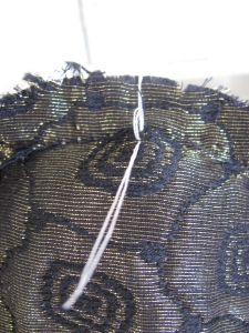 Tailor tack on inside of shoulder sleeve at the crown of the sleeve