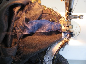 sewing the blue stays back in the English jacket