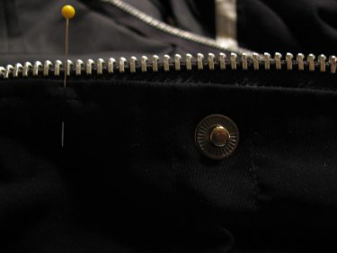 zipper teeth above snap on jacket, 1419