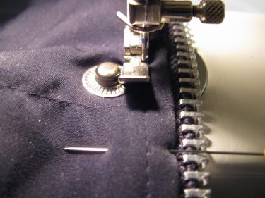 close up showing how I sew the zipper in using the original stitching line, black jacket, sewing blog 1415