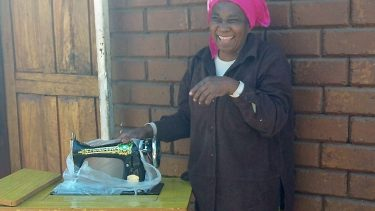 zambian mama getting a sewing machine, 0723