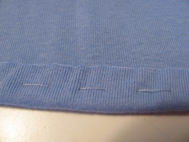 knit hem pressed up after elastic is cut off, 1438