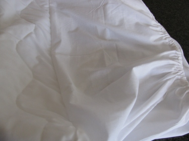 photo of the mattress pad attached, IMG_7566