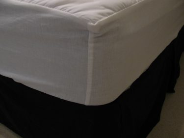 close up of corner on mattress pad on bed